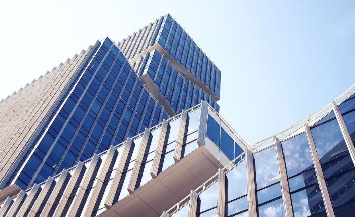 large tall building with glass front - corporate